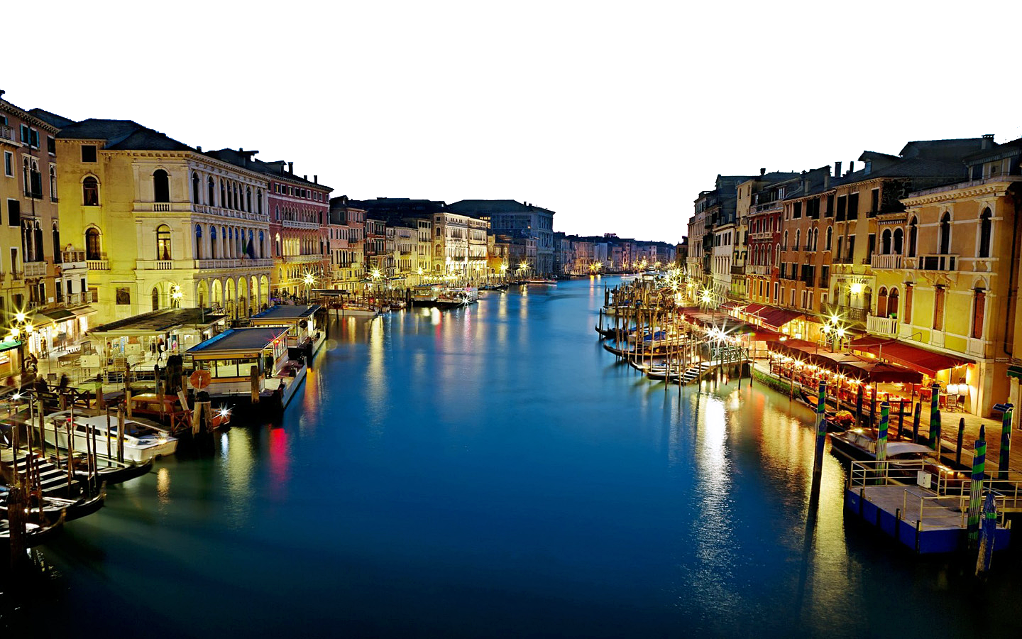 Deep Blue Sea and Lighted Buildings – Italy