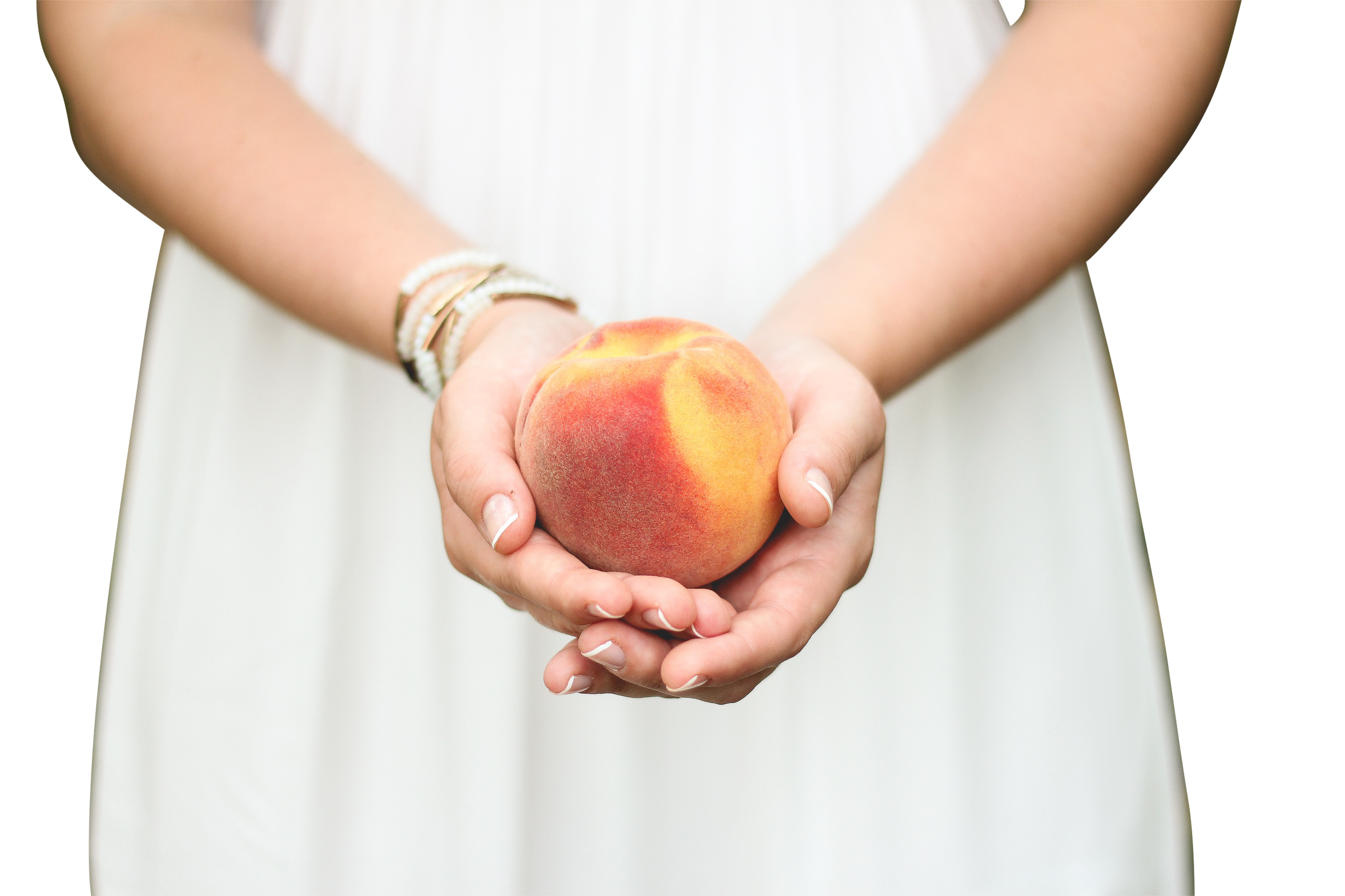 Peach in a Girl's Hands