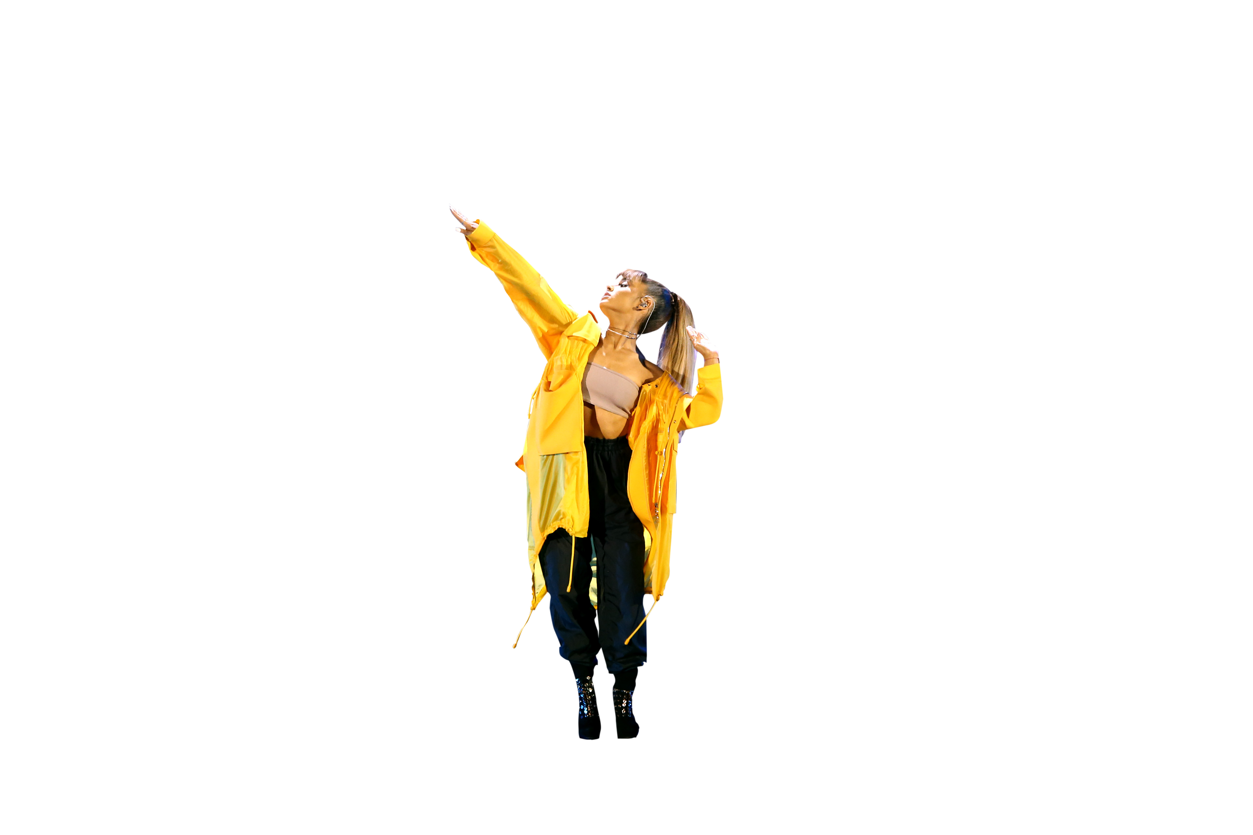 Ariana Grande in yellow dress on stage