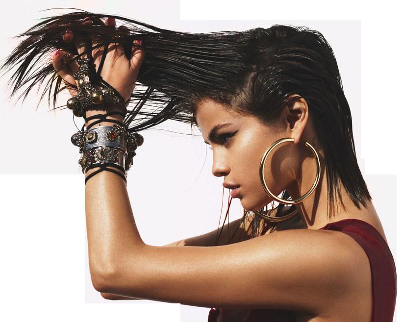 Sexy Selena Gomez holding her Hairs