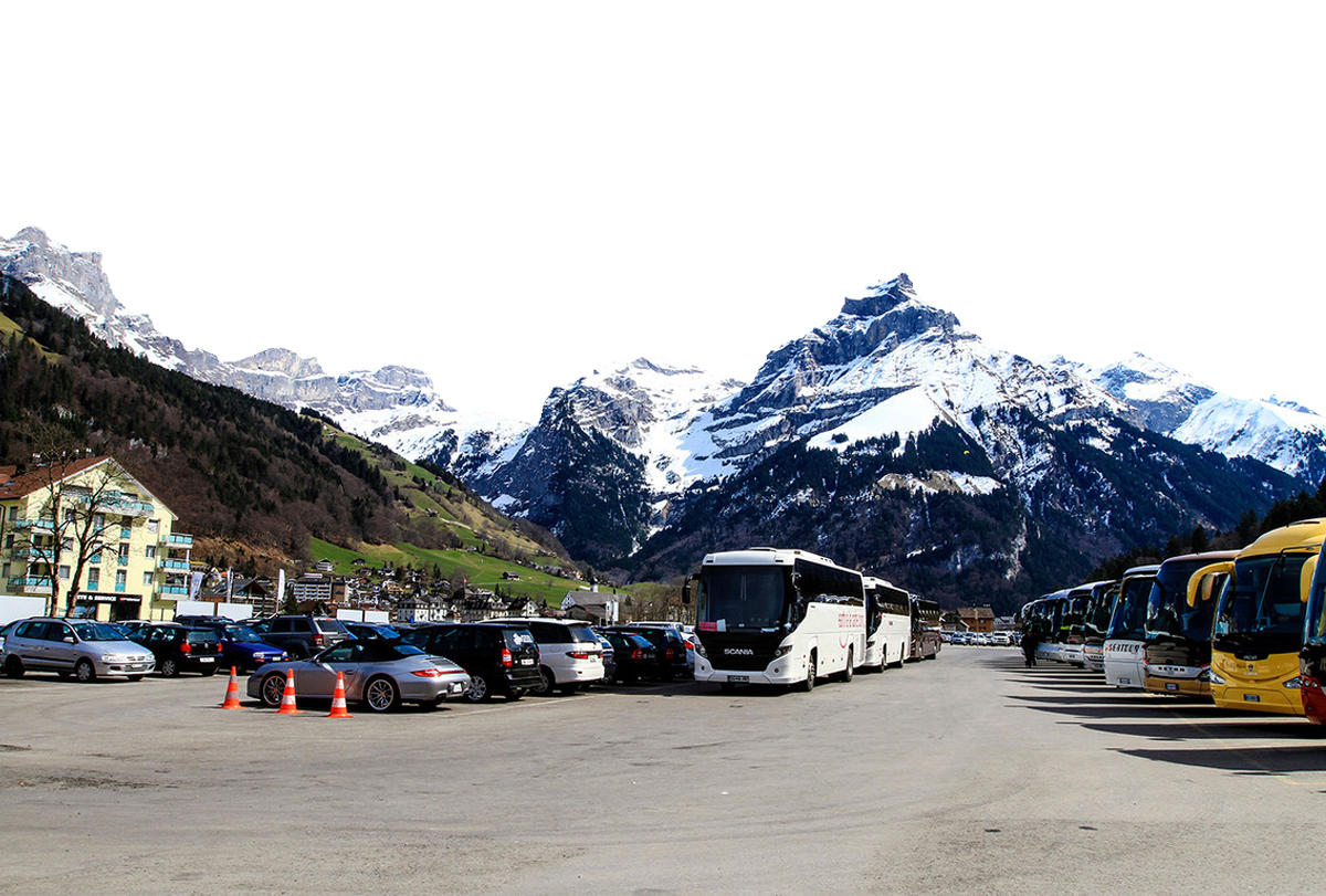Parked Buses and Cars by the Alps