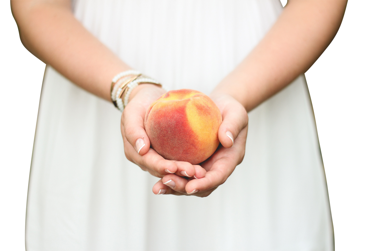 Peach in a Girl's Hands PNG Image