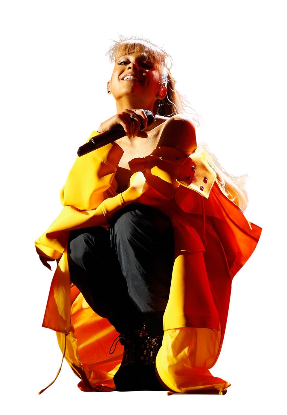 Ariana Grande in yellow dress on stage PNG Image