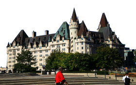 Man and Woman walk by Building in Canada PNG