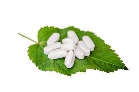 White Pills on a Leaf PNG